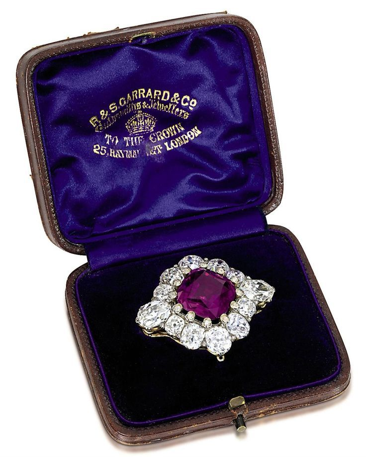 AN ANTIQUE PURPLE SAPPHIRE AND DIAMOND BROOCH. The square-shaped reddish-purple sapphire held by diamond-set claws to the cushion-cut diamond surround with oval and hexagonal-shaped old-cut diamond shoulders, mounted in silver and gold, circa 1870, in original brown leather fitted case by Garrard & Co. #antique #Victorian #brooch