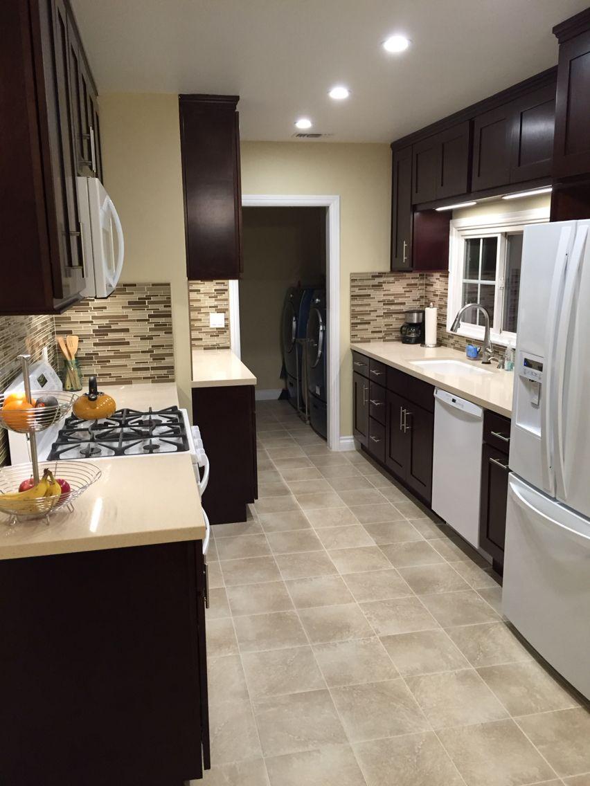 Espresso kitchen cabinets with white appliances cocinas