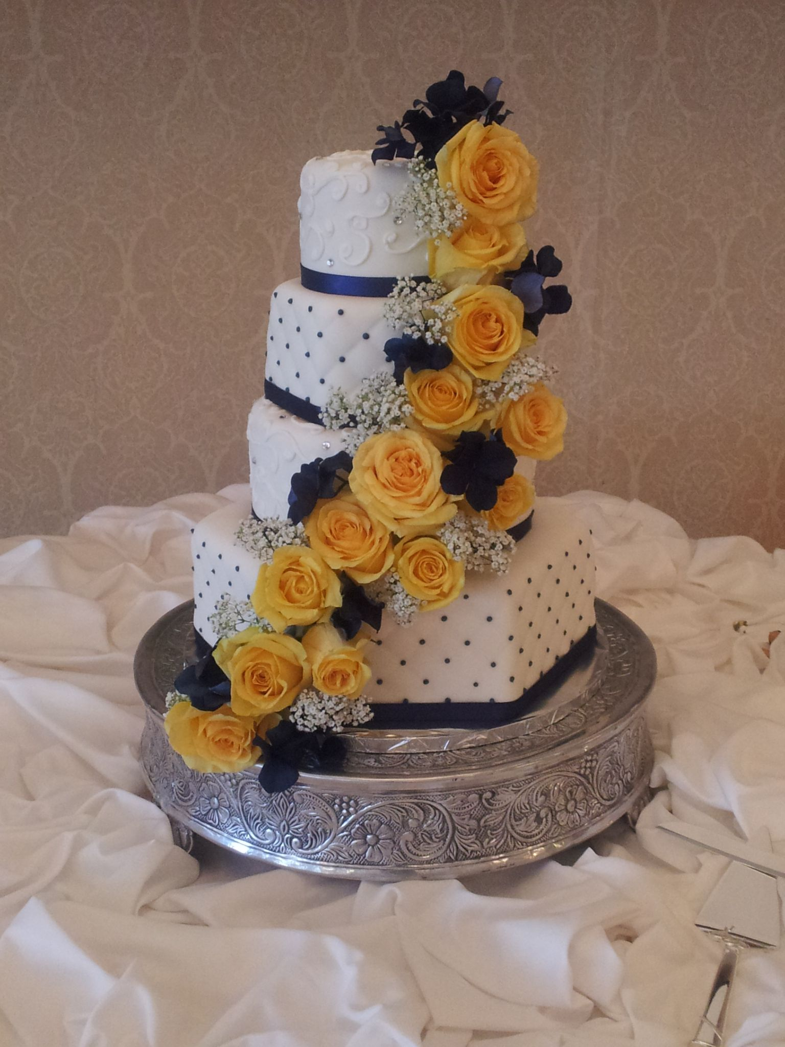 Stunning Navy theme cake with beautiful accented yellow roses www