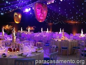 Glamourous Venice Themed Wedding Tent With Carnevale Masks Hanging From The Roof