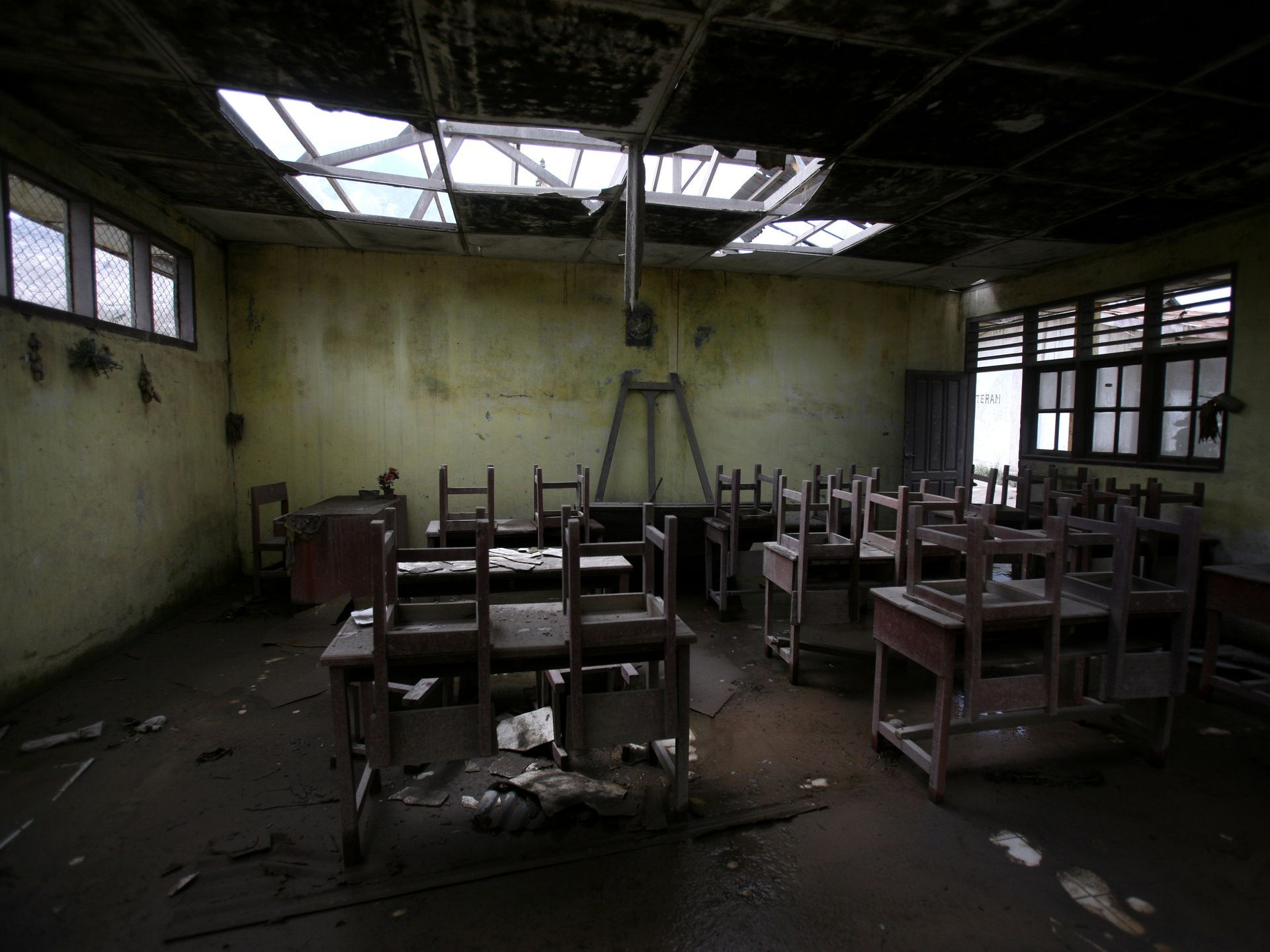 Chairs Rest On Tables In An Empty Classroom At Elementary