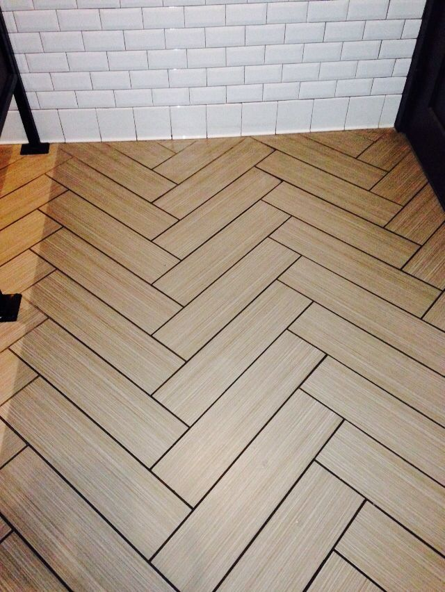 Ceramic Tile Floor With Wood Grain Laid Out In A Fish Bone Pattern