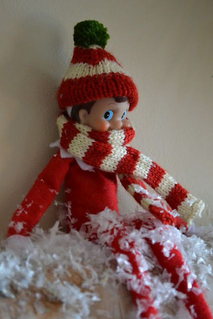 elf with hand knit scarf and hat