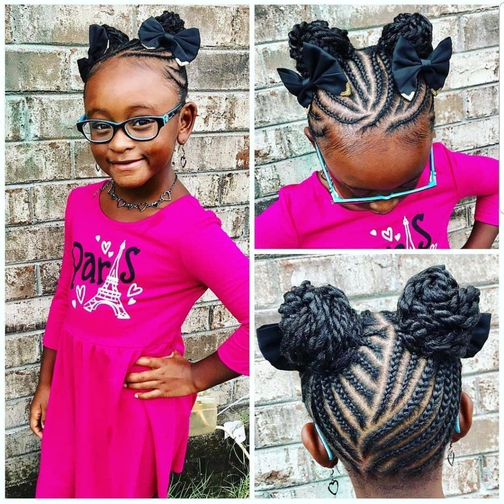 Little Black Girl With Cornrows Leading To Two Braided Buns Adorned With Hair Bows Kids Braided Hairstyles Kids Hairstyles Braided Bun Hairstyles