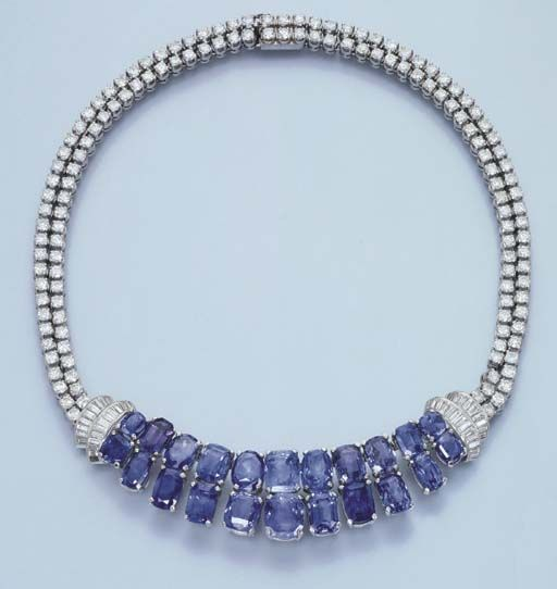 Christie's  A SAPPHIRE AND DIAMOND FRINGE NECKLACE  The central cushion-cut sapphire two-row fringe flanked by baguette-cut diamond curved panels to the brilliant-cut diamond twin-row backchain, circa 1935, 40.2 cm. long, with French import mark for platinum