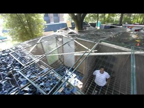 This is an outdoor maze made of panels.  A screen hangs above the all the maze panels with material hanging down to the floor to disorient people walking through.  They explain how they do it. Haunt Ventures Ep. 120 - Maze of Killer Clowns - YouTube