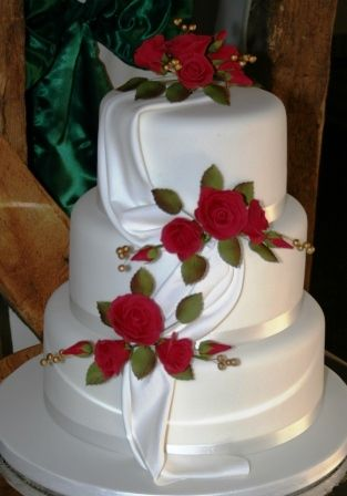 Wedding Cake With Red Roses And Drape