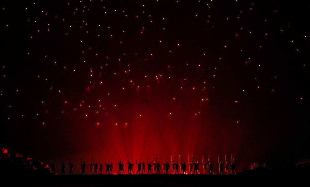 Actors perform a theatrical re-enactment of the Red Army and the beginning of the Long March in Jinggangshan, Jiangxi province, China, on September 20, 2012. Jinggangshan is where former Chinese leader Mao Zedong's career as a revolutionary began to take