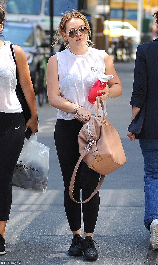 In step:The Lizzie McGuire vet's shirt had no sleeves, was fashionably knotted in the fro...