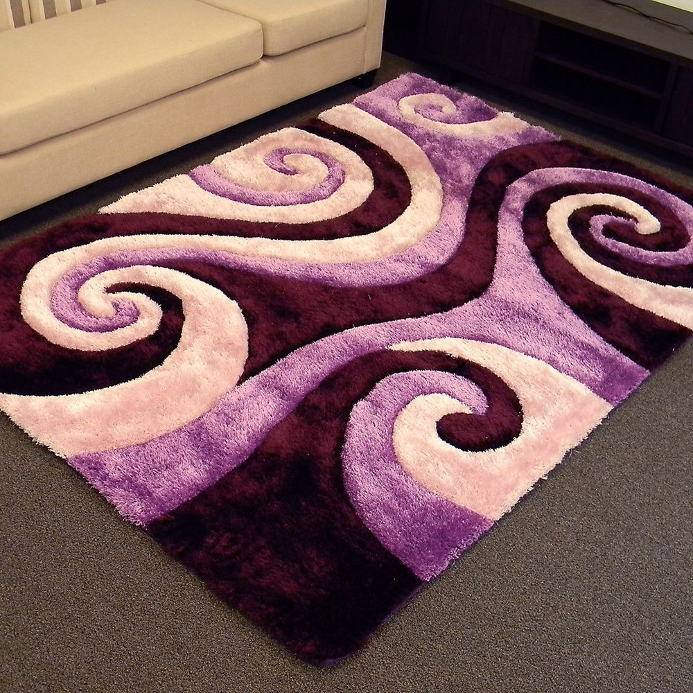 this plush shaggy area rug features an abstract swirl of ivory and shades of purple to