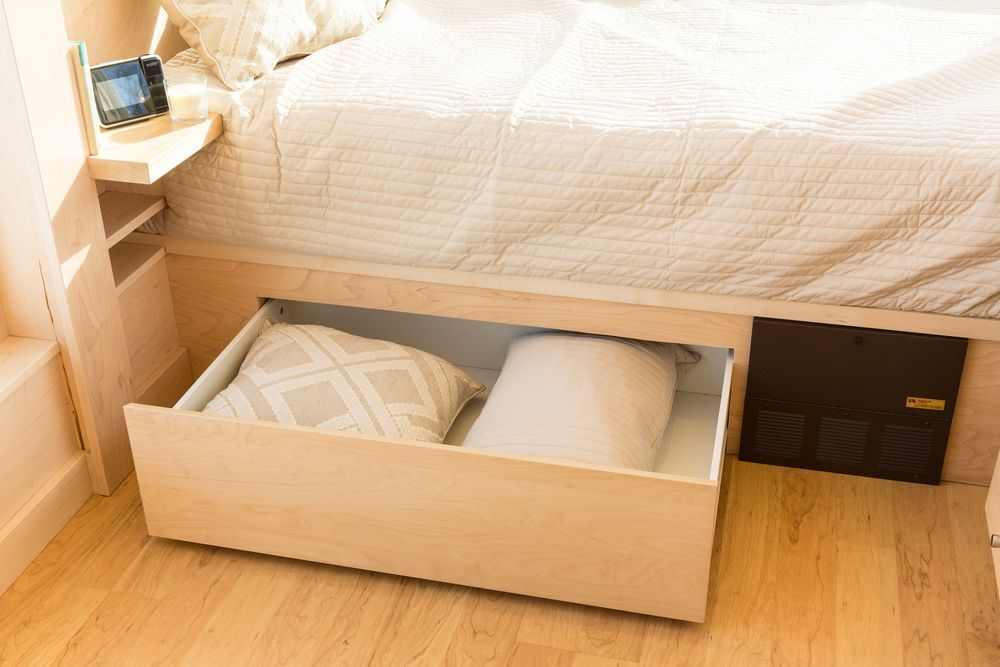 Under-the-bed storage in a tiny house.