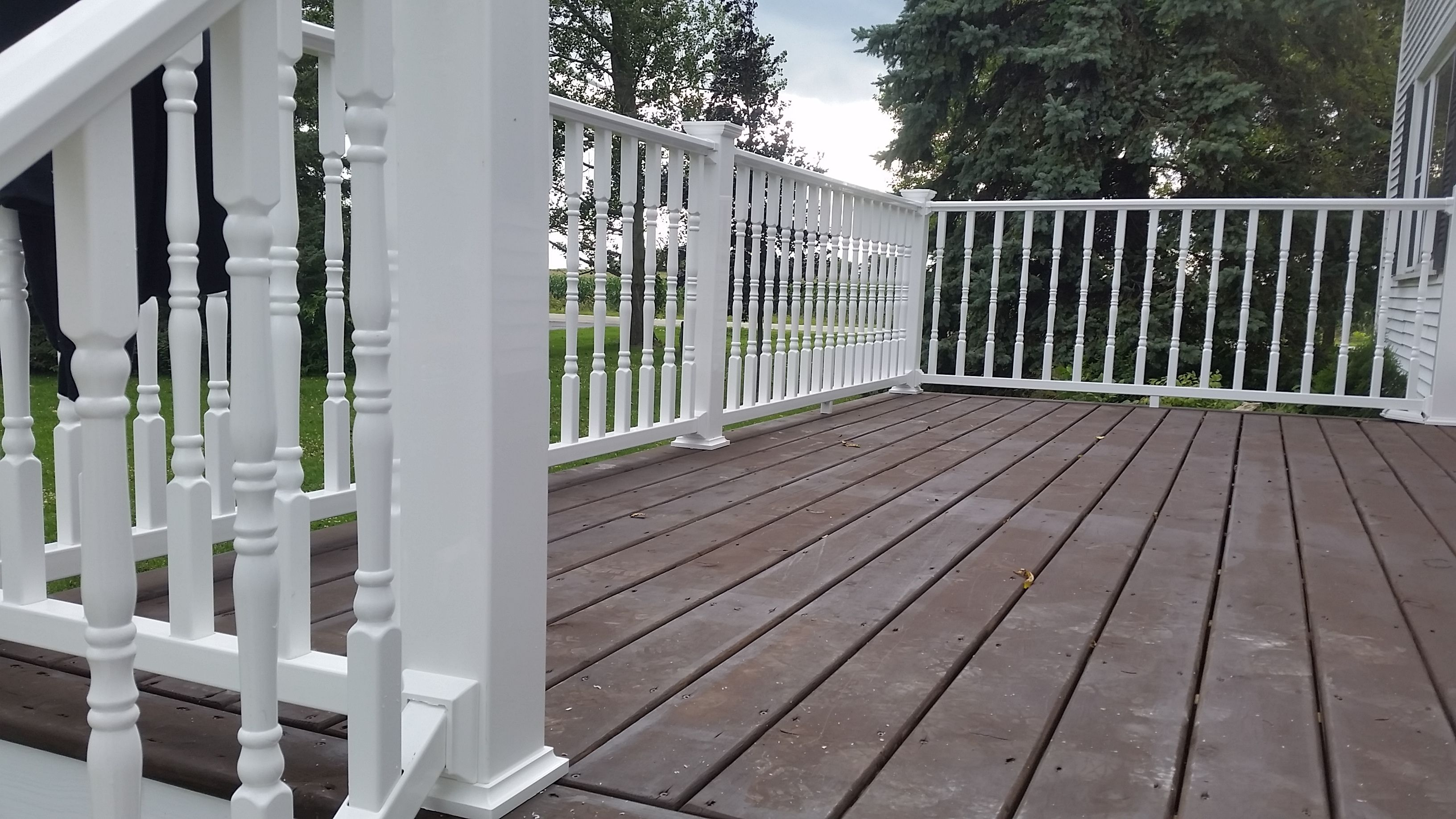 Trx White Vinyl Railing With Colonial Balusters And A Treated Pine Decking With Zar Acorn Brown Deck Siding Stain Outdoor Rooms Cottage Garden Outdoor Living