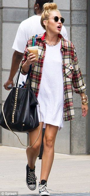 cb93a10e95 Legs on show  The actress and singer teamed the shirt with a T-shirt dress  and Converse trainers