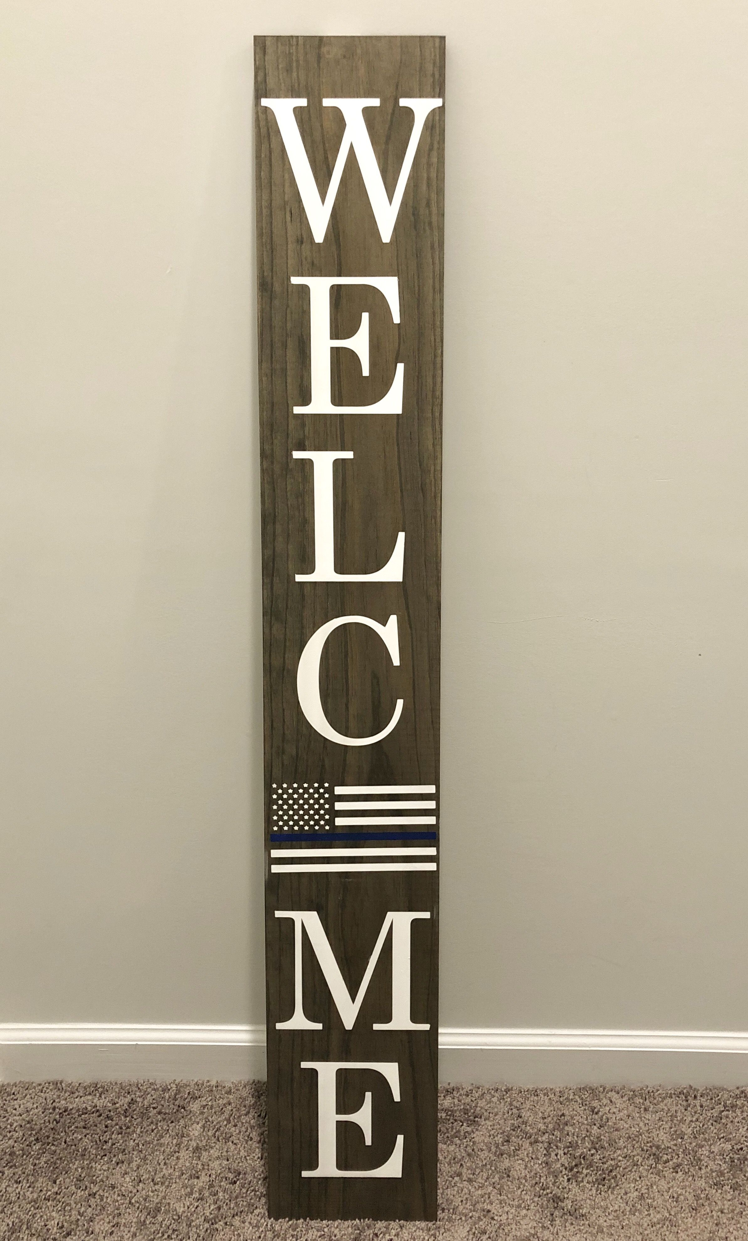 Handmade porch welcome sign. Grey stained wood with white stenciled letters. Currently selling for $50 (does not include shipping). Check out my Facebook page to place your order!   #handmadecrafts #cricutmade #farmhousesign #rustichomedecor #rusticdecor #farmhousedecor #doorhanger #doorsigns #frontdoordecor #frontdoorgoals #homedecoration #homesweethome #homedecorating #cricutmaker #farmhousedecor #farmhousestyle #farmhouse #porchsigns #welcomesign #porchdecor #porchdecorating