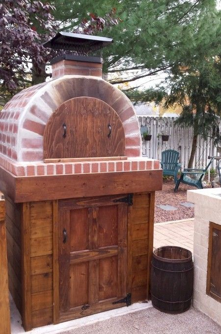 This Diy Wood Fired Brick Pizza Oven Sits On A Wood Veneer Pizza
