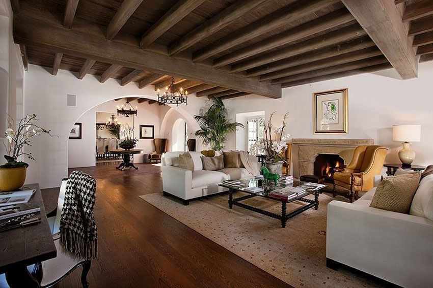 craftsman living room with white walls large arched doorway and wood beam ceiling - Craftsman Living Room