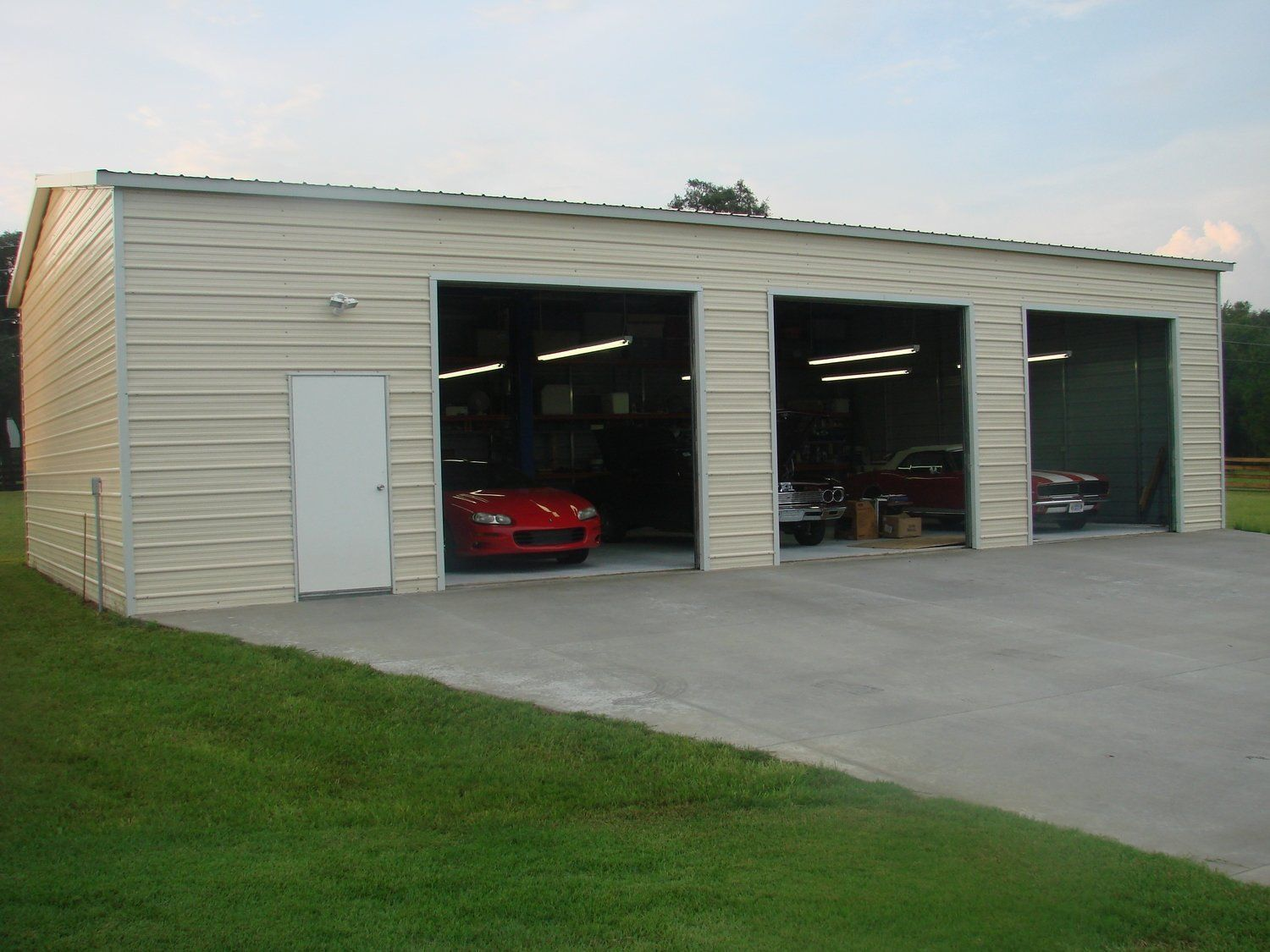 Three Car Garage 24 X 50 X 12 With Three 10 X 10 Roll Up Doors And One Walk In Door Store Metal Garage Buildings Garage Door Design Steel Garage Buildings