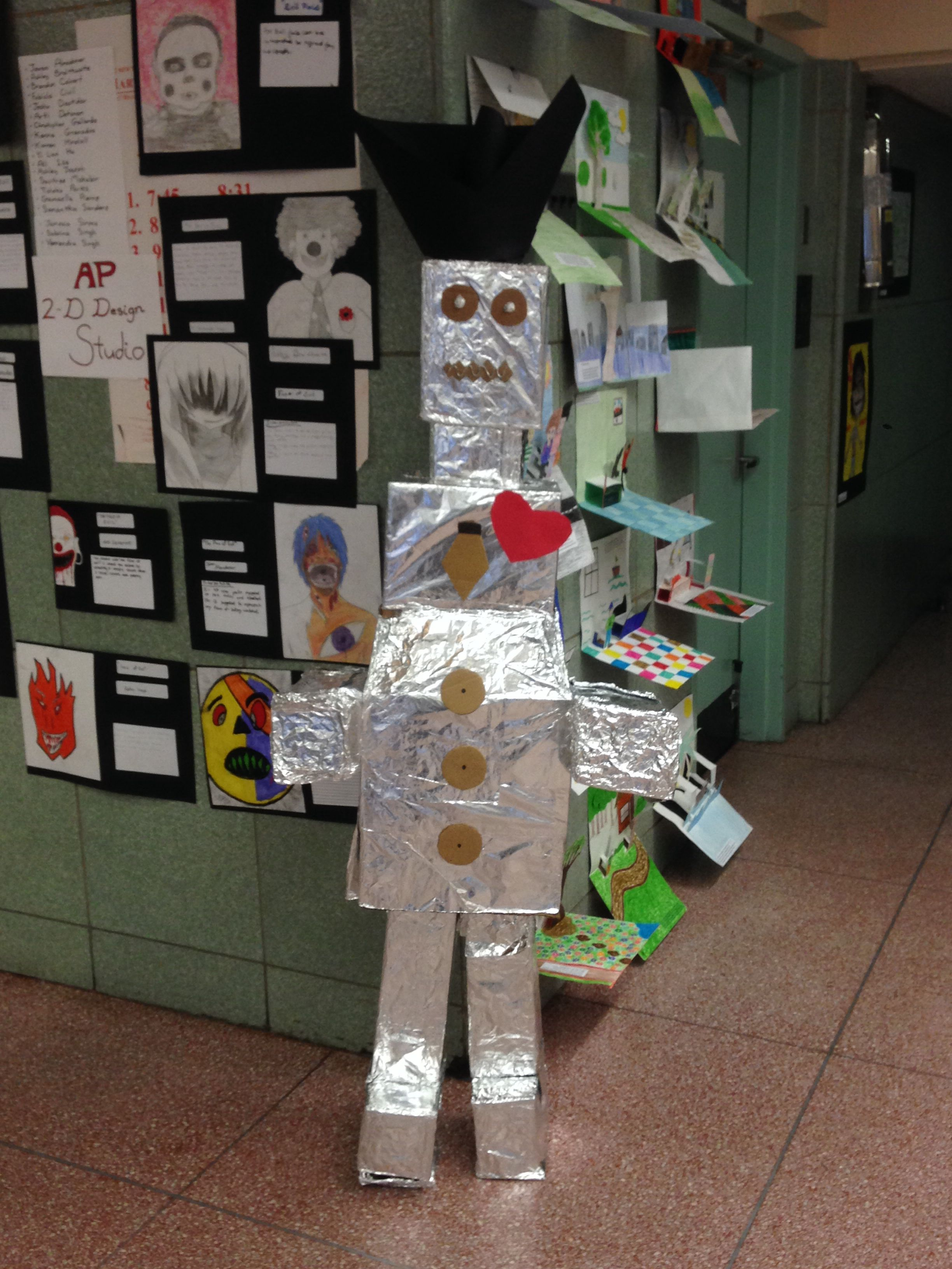 This was made by high school students. I put about 5-6 students in groups and they had to come up with a design for their life size figure that was then made out of cardboard. This was during while I student taught for two 3D classes.