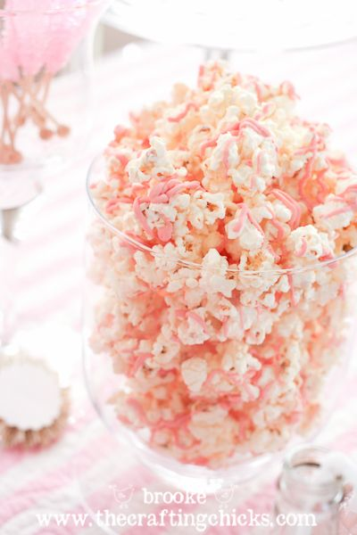 ~ Popcorn drizzled with pink chocolate candy melts. So easy and pretty for a Valentine sweet table.