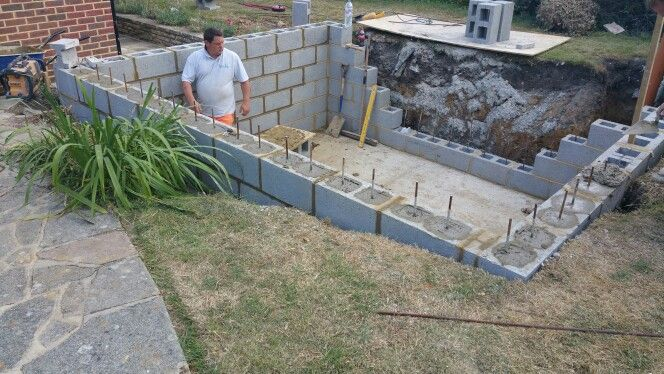Concrete block work for a fish pond piscina pinterest for Concrete swimming pool construction