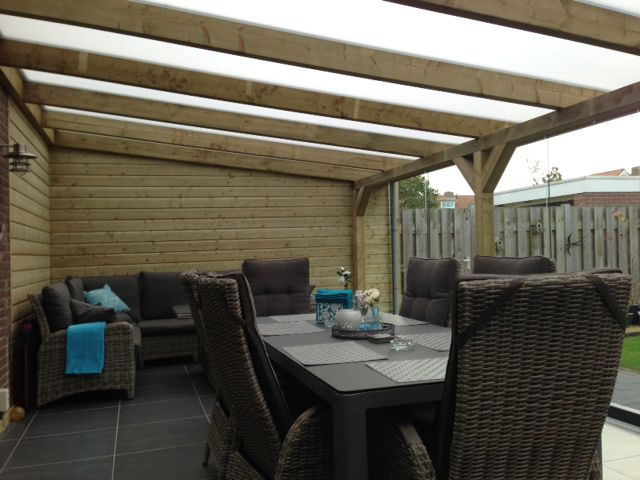 Voorbeeld van terrasoverkapping met dakbedekking van melkwitte
