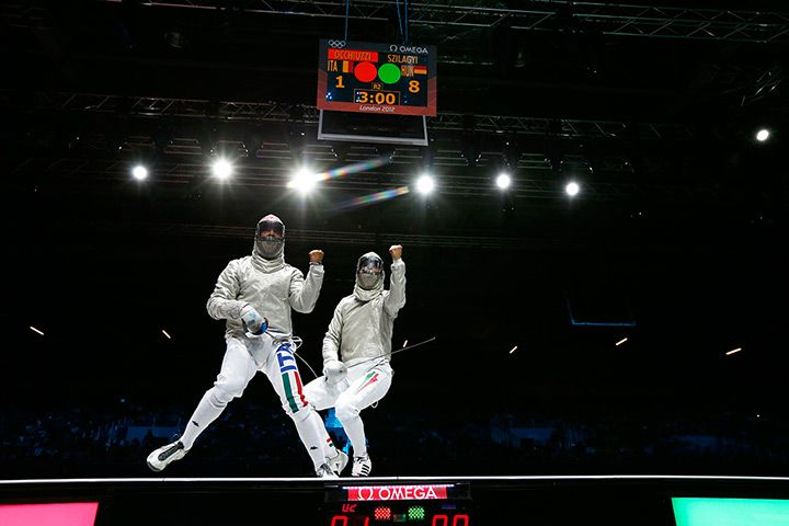 Italy's Diego Occhiuzzi and Hungary's Aron Szilagy during the men's fencing individual sabrePhotograph: Max Rossi/AP