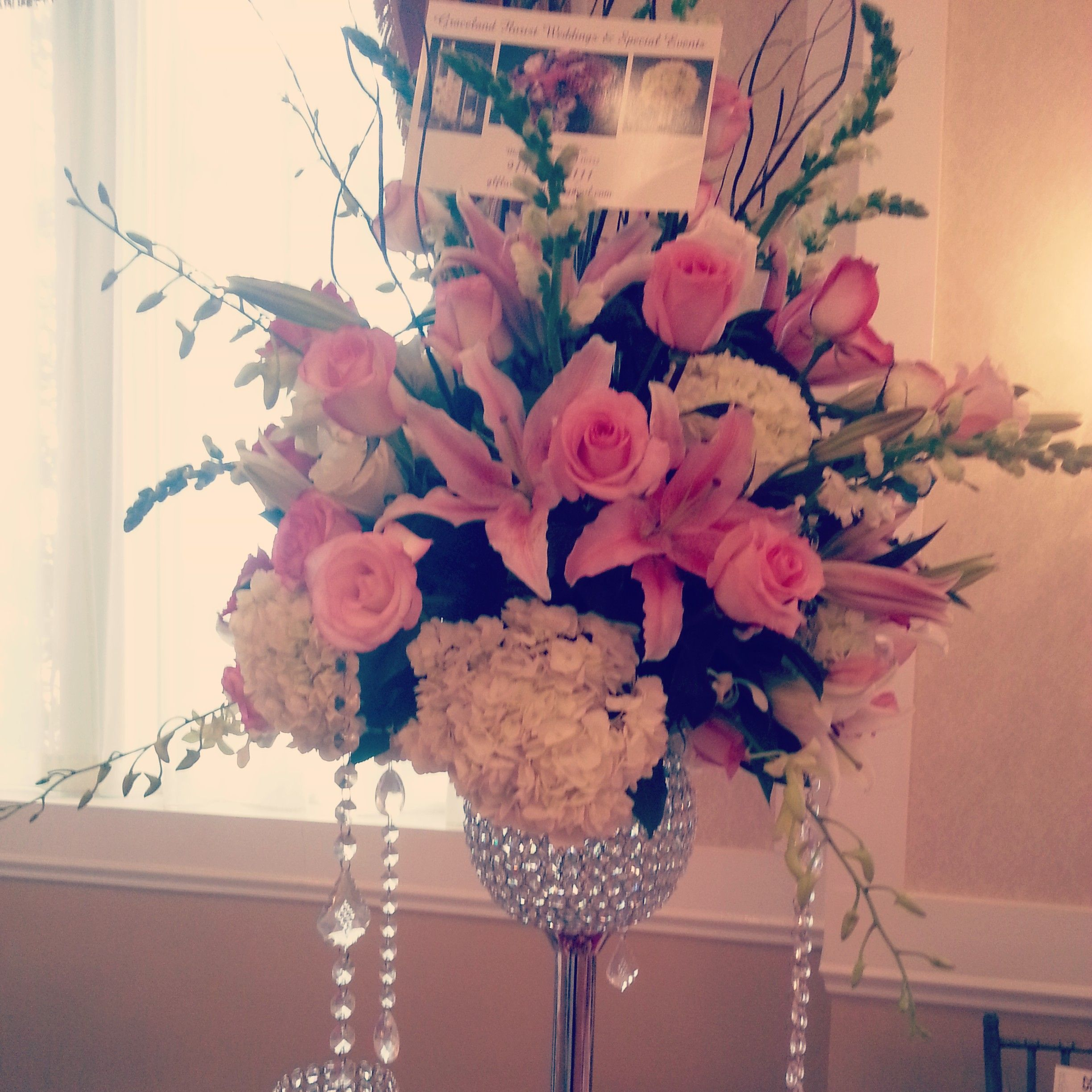 Stargazer lily wedding centerpiece with pink roses, white ...
