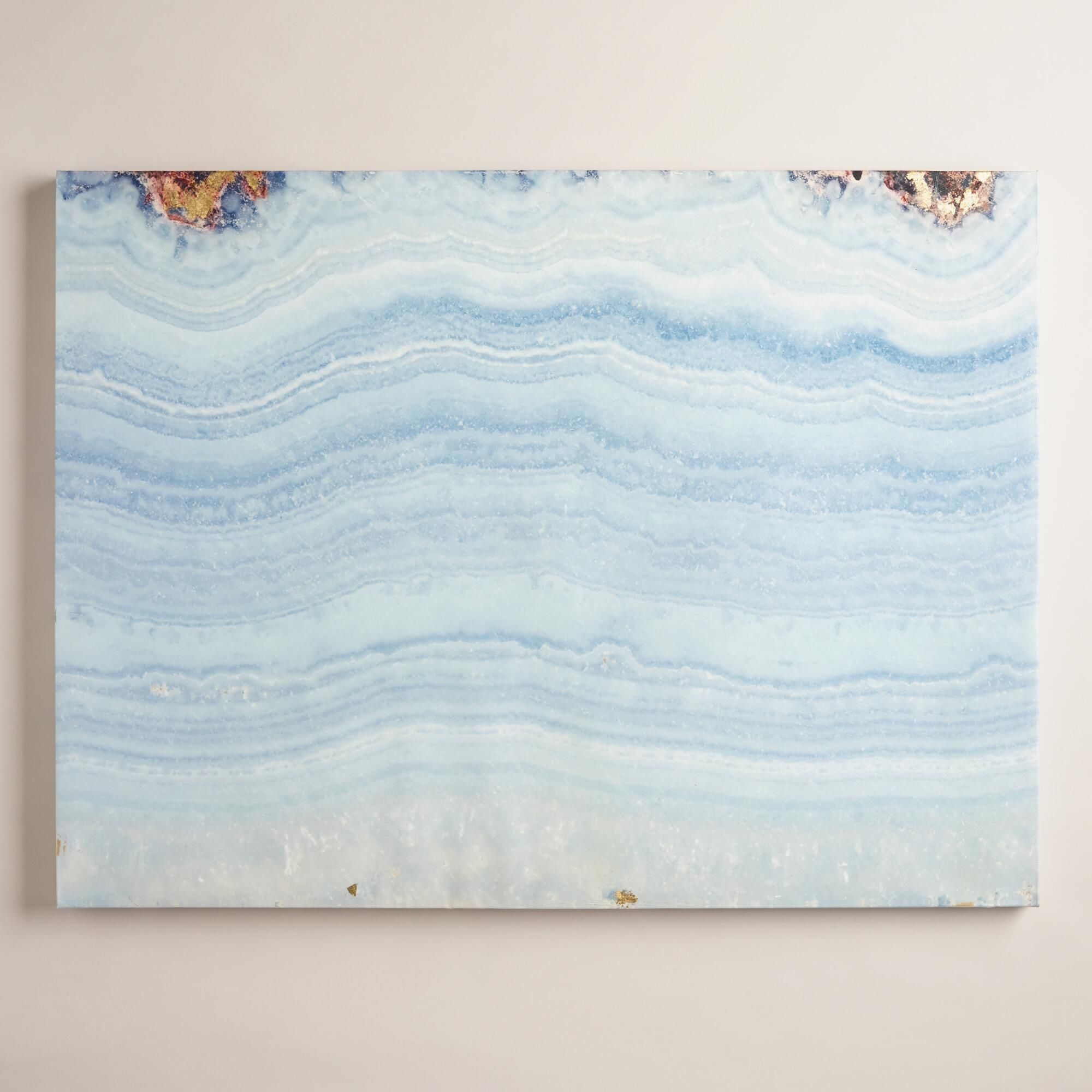 Featuring shades of blue and gray with golden accents our wall art