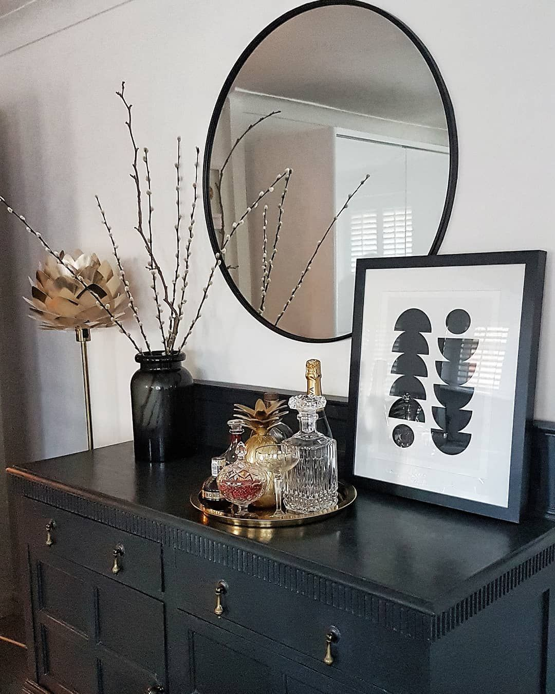 Round Black Frame Mirror Dark Painted Dresser And Touches Of