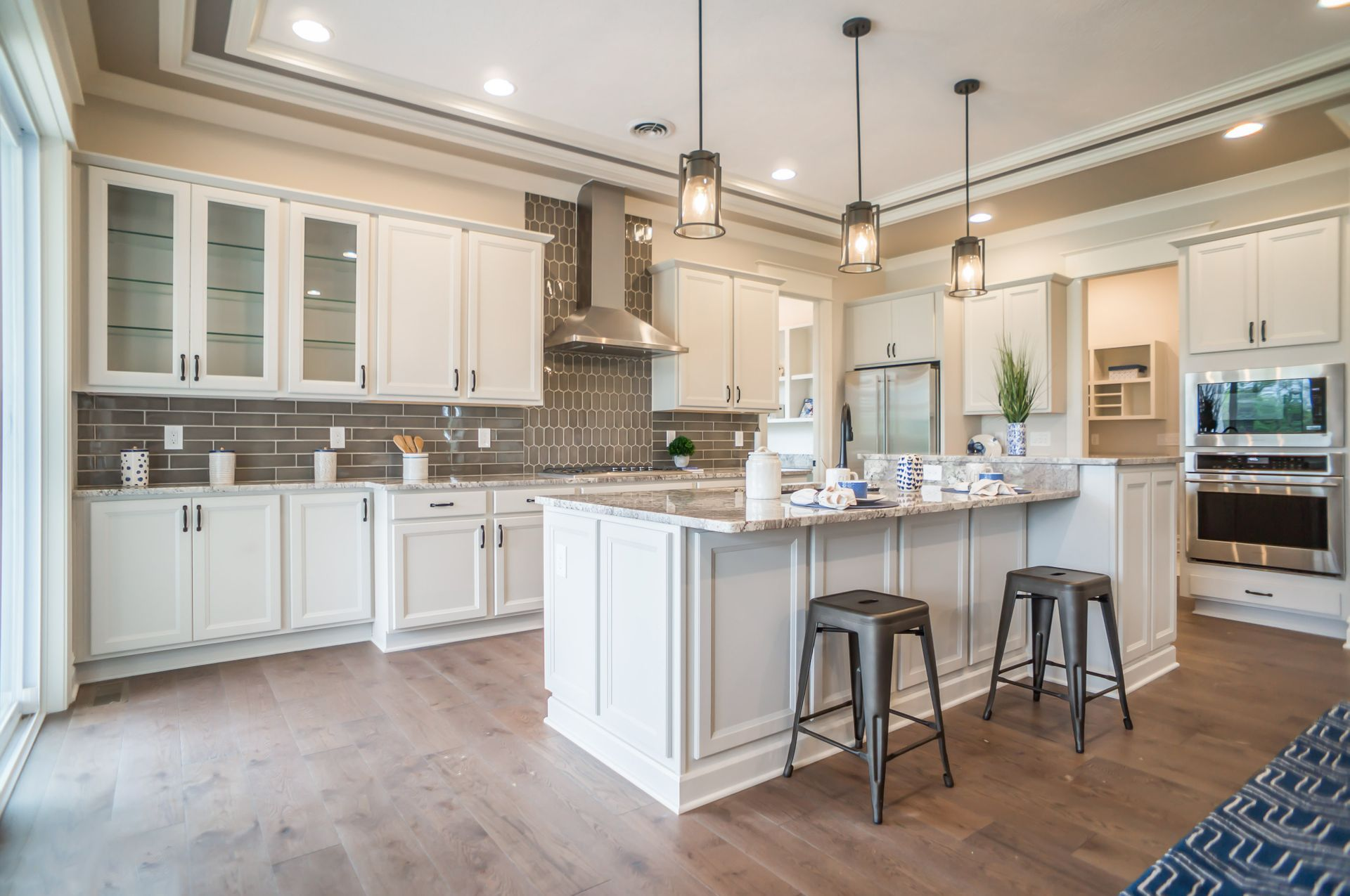Tile Extends All The Way To The Ceiling Even Though The Cabinets Do Not Large Laundry Rooms Great Rooms Okemos