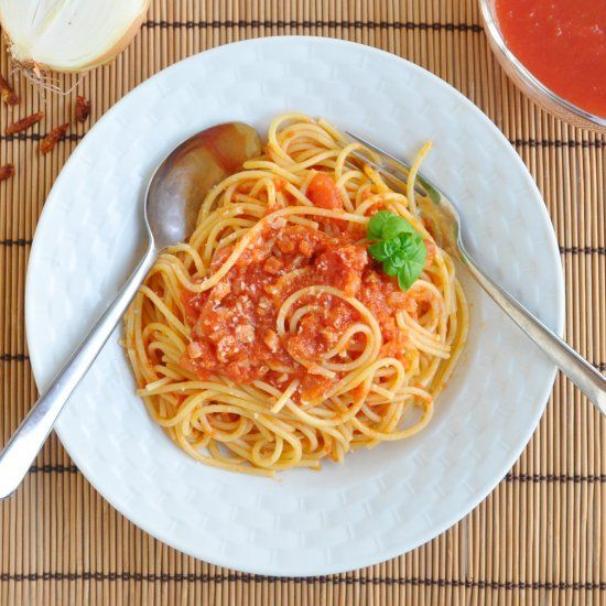 Traditional and classic Italian Spaghetti all'Amatriciana, with spicy crushed tomatoes, savory pancetta, and fresh, sweet basil.