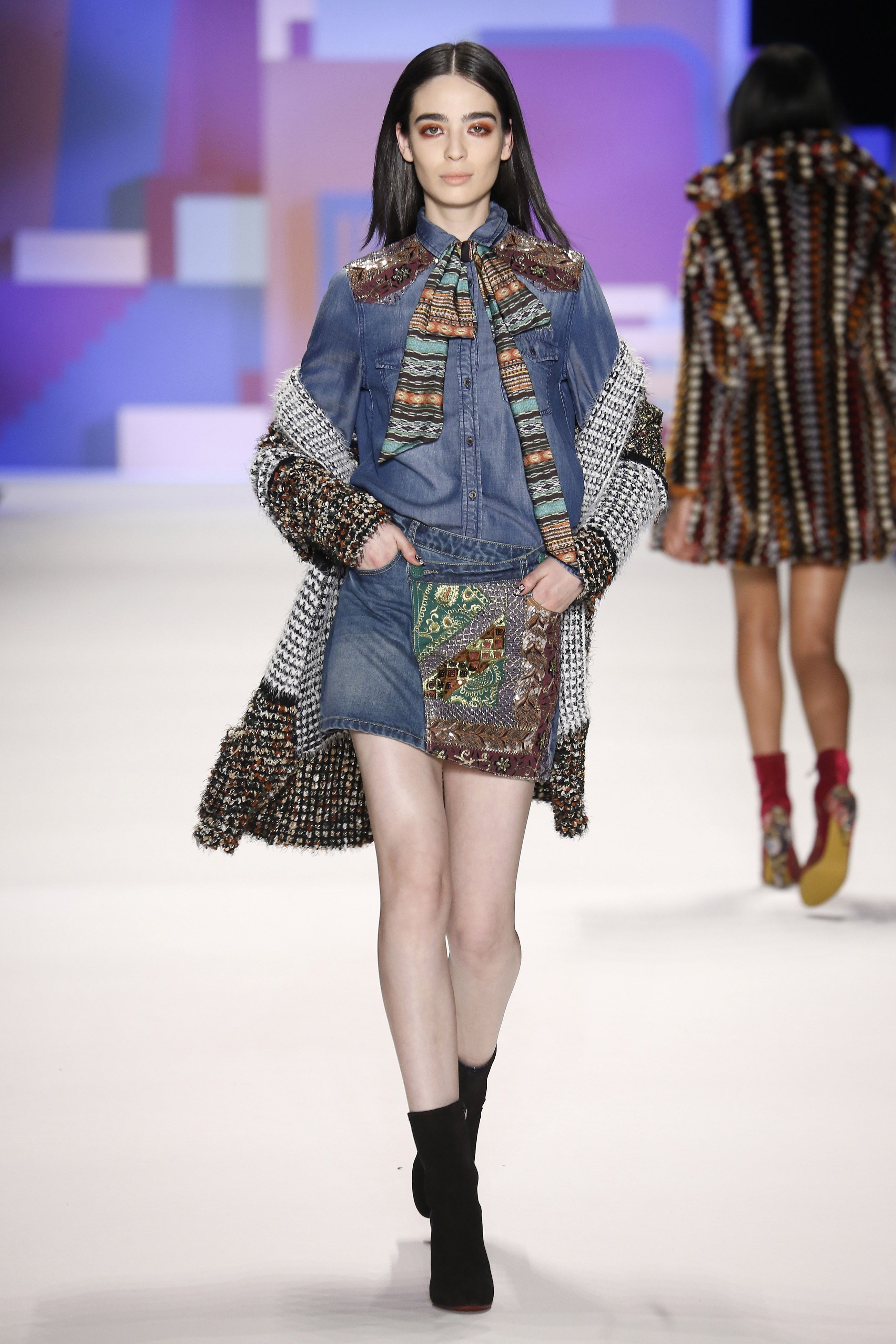 Denim features in Desigual's AW16 collection but in a revised form. Denim shows its more creative side with embroidery and Hindu details. The new take on jeans includes tweed and men's tailoring fabrics