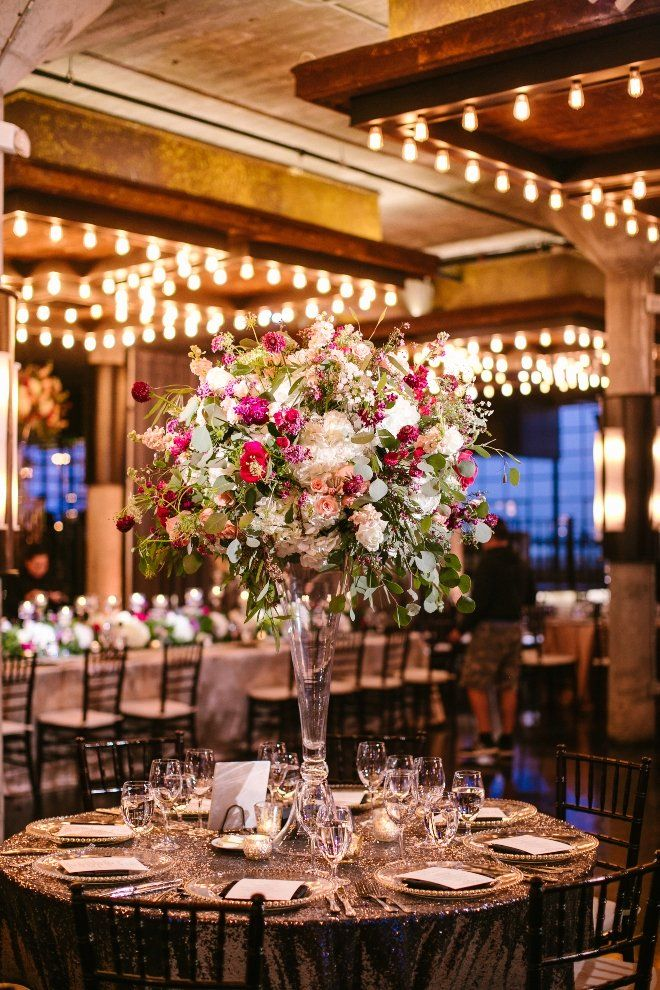 """Our wedding design was 'modern elegance' with garden accents of pink florals, greenery and marble table numbers and signs. The lighting from the Edison bulbs at The Astorian gave everything a warm glow which was really beautiful."" 