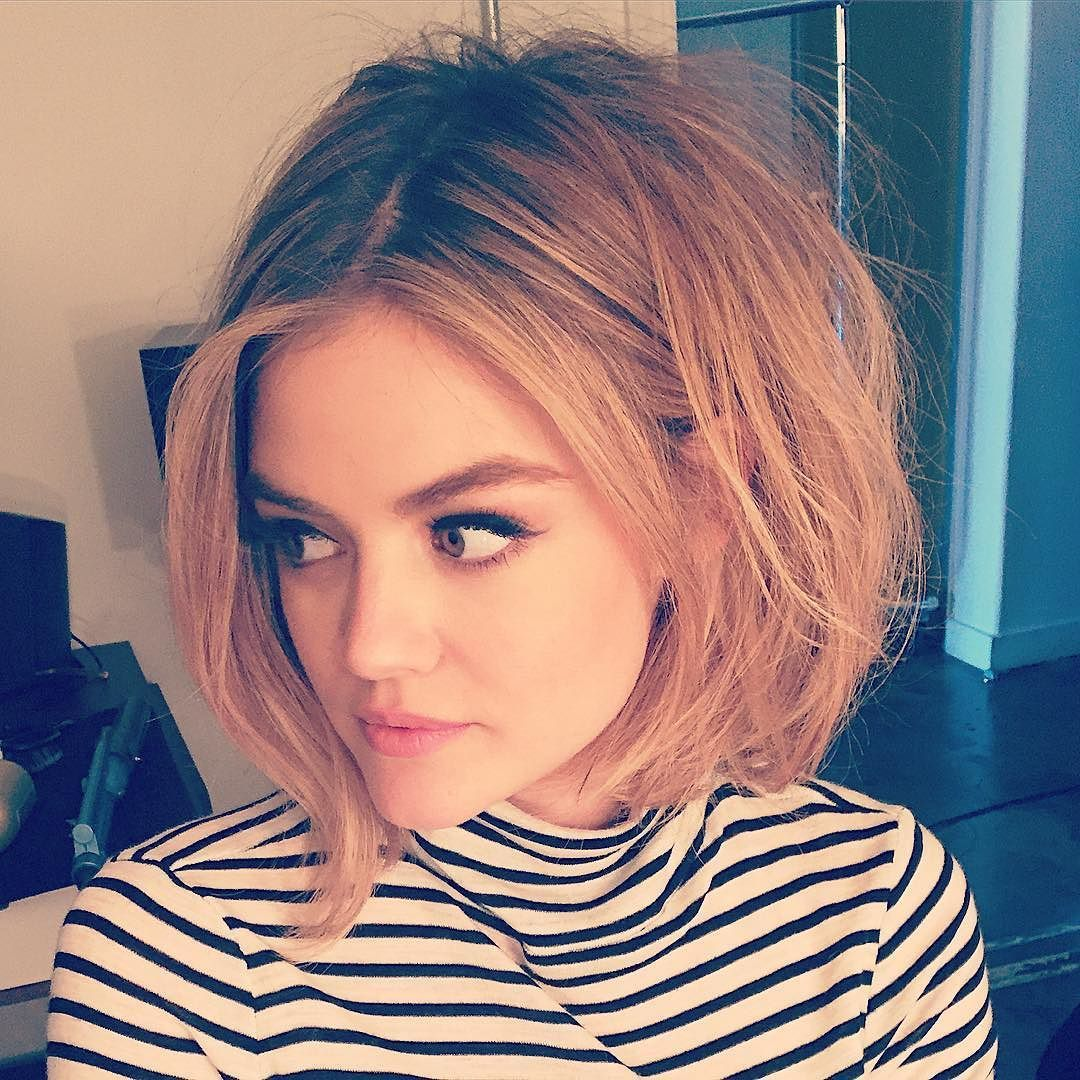 lucy hale hair and makeup - short bob, thick eyebrows, and winged