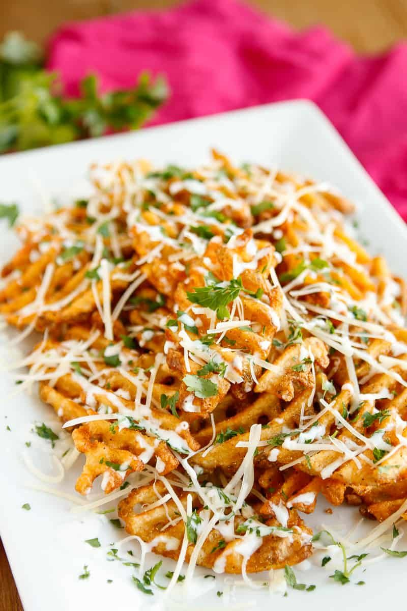 Parmesan garlic waffle fries with ranch dressing side