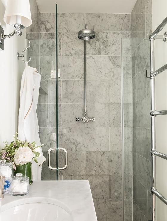 Fabulous Bathroom Features A Walk In Shower Clad Grey Marble Tiles Lined With Vintage Exposed Plumbing Head Finished Seamless Gl Door
