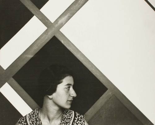 "Cesar Domela. Ruth, 1928. CŽesar Domela shows his wife Ruth in front of one of his paintings: a Van Doesburg-like ""counter composition"" with diagonal lines. Following Van Doesburg´s example, in the 1920s Domela broke with Mondrian´s ""neoplastic´s aesthetic of equilibrium, which was based on an essentialist opposition between vertical (male) and horizontal (female)."