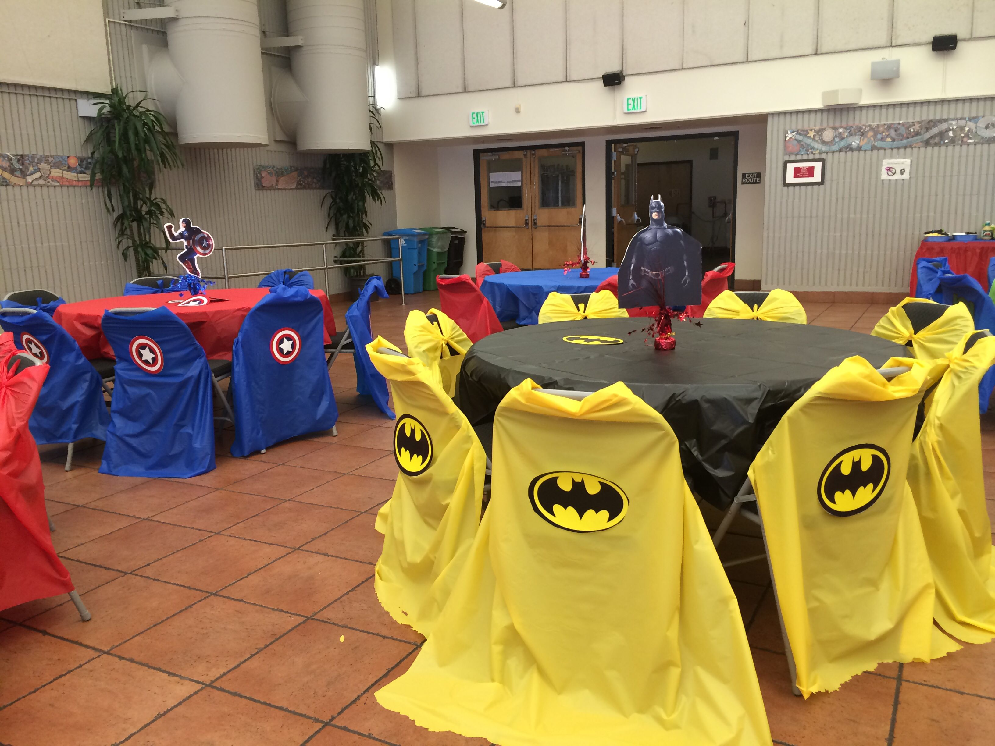 Bat Man & Captain America. I used plastic covers and made capes for the chair covers