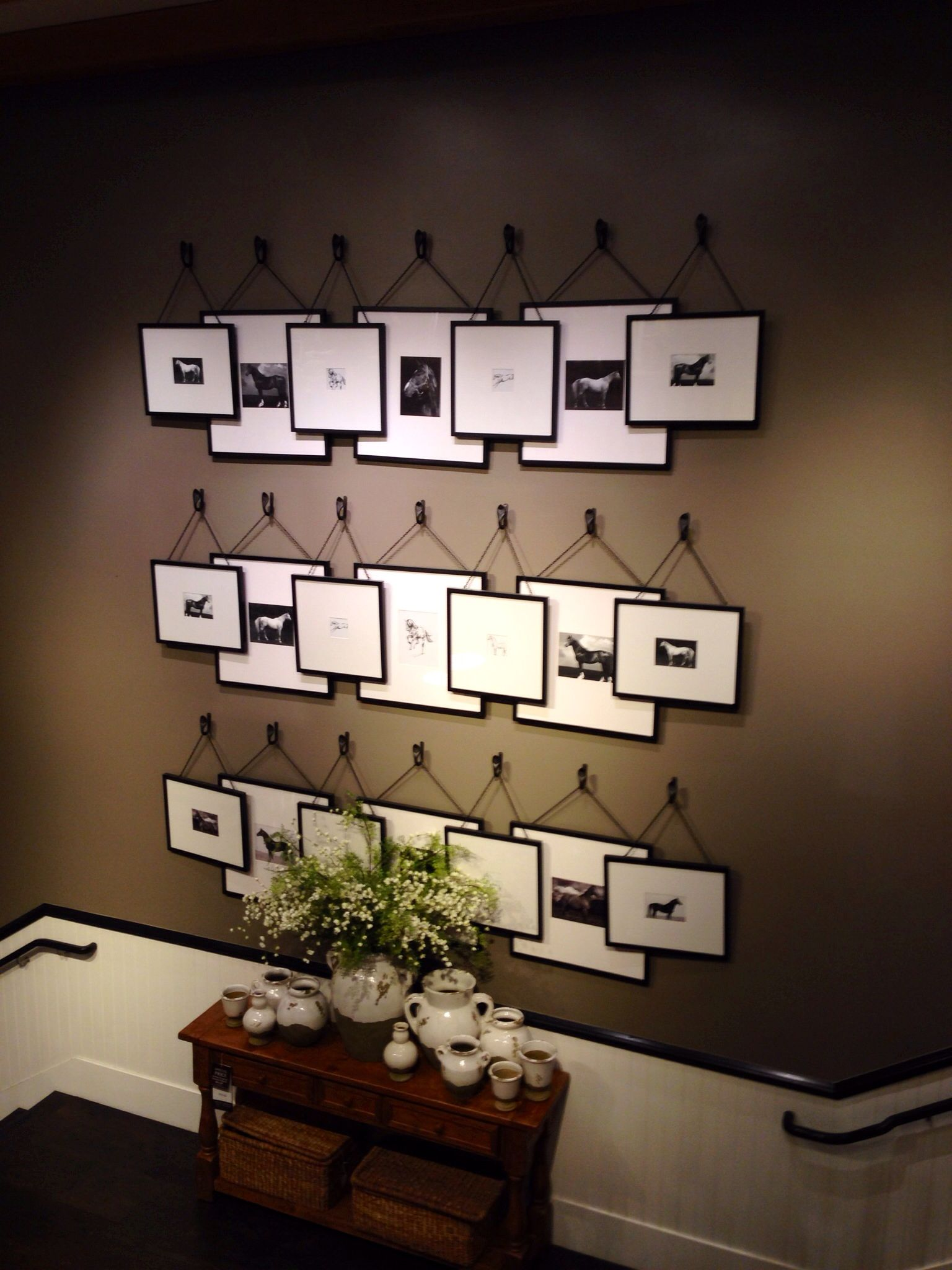 overlapping picture frames hanging from hooks pottery barn house upgrades pinterest. Black Bedroom Furniture Sets. Home Design Ideas