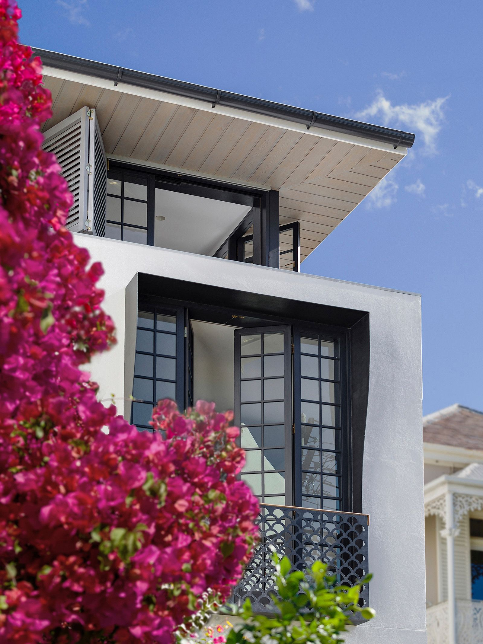 Bougainvillea Row House is a modern terrace house designed by ...