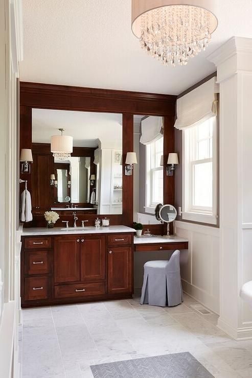 Beautiful Bathroom Features A Washstand With Cherry Wood Cabinets Adorned With Nickel Pulls