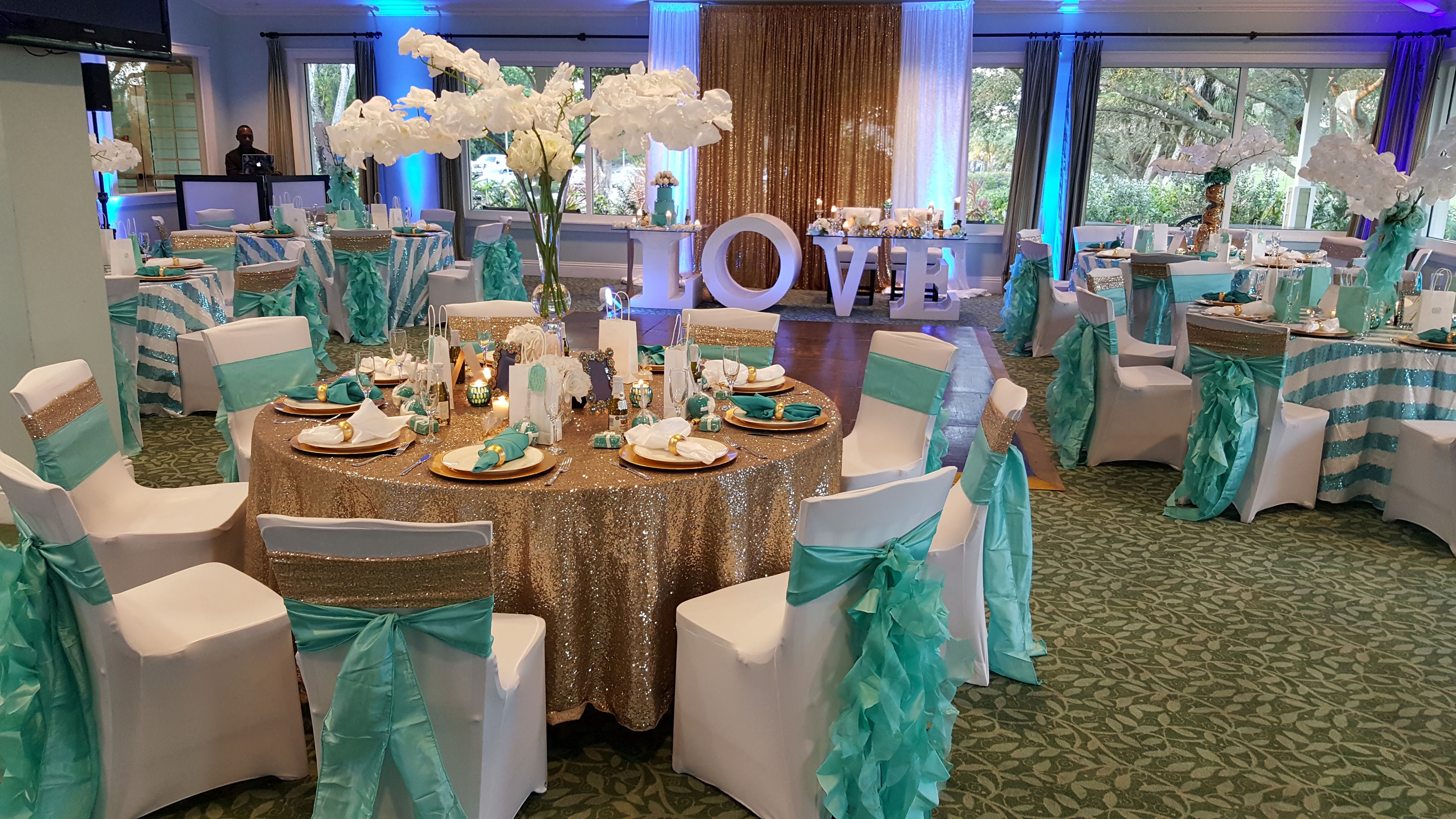 Turquoise, white, and gold wedding reception with stripes and sequin  tablecloths | Eve… | Gold wedding theme, Gold wedding reception, Gold  wedding table decorations