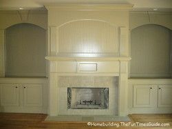 Recessed bookshelves with bead board flank this magnificent fireplace.