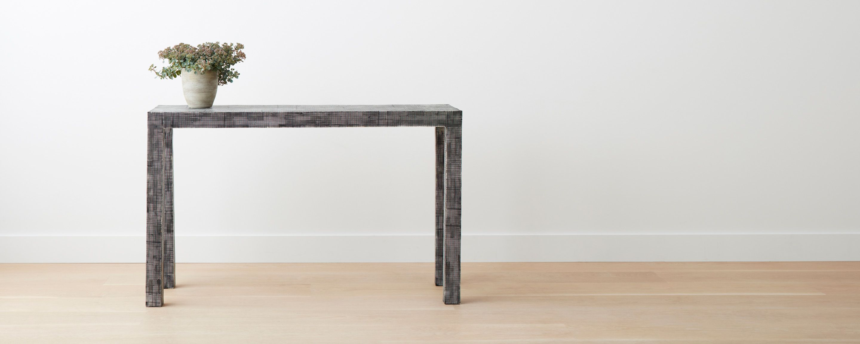 A Parsons Style Console Table, With A Textural Pattern Created By The Hand