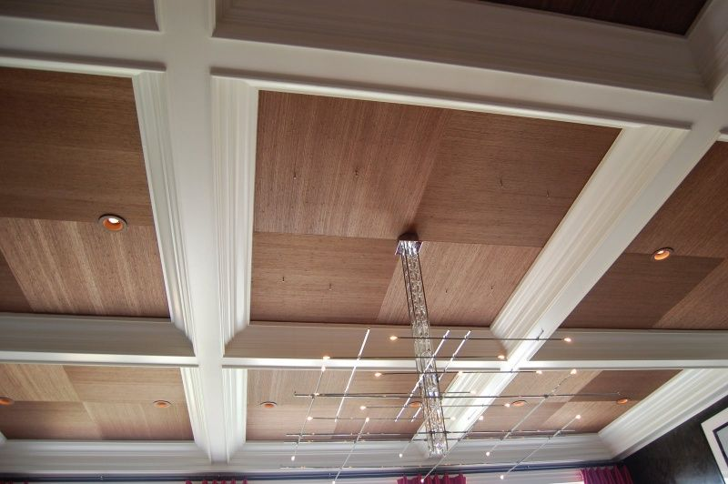 Ceiling Design Ideas. Wooden panels with white moulding.