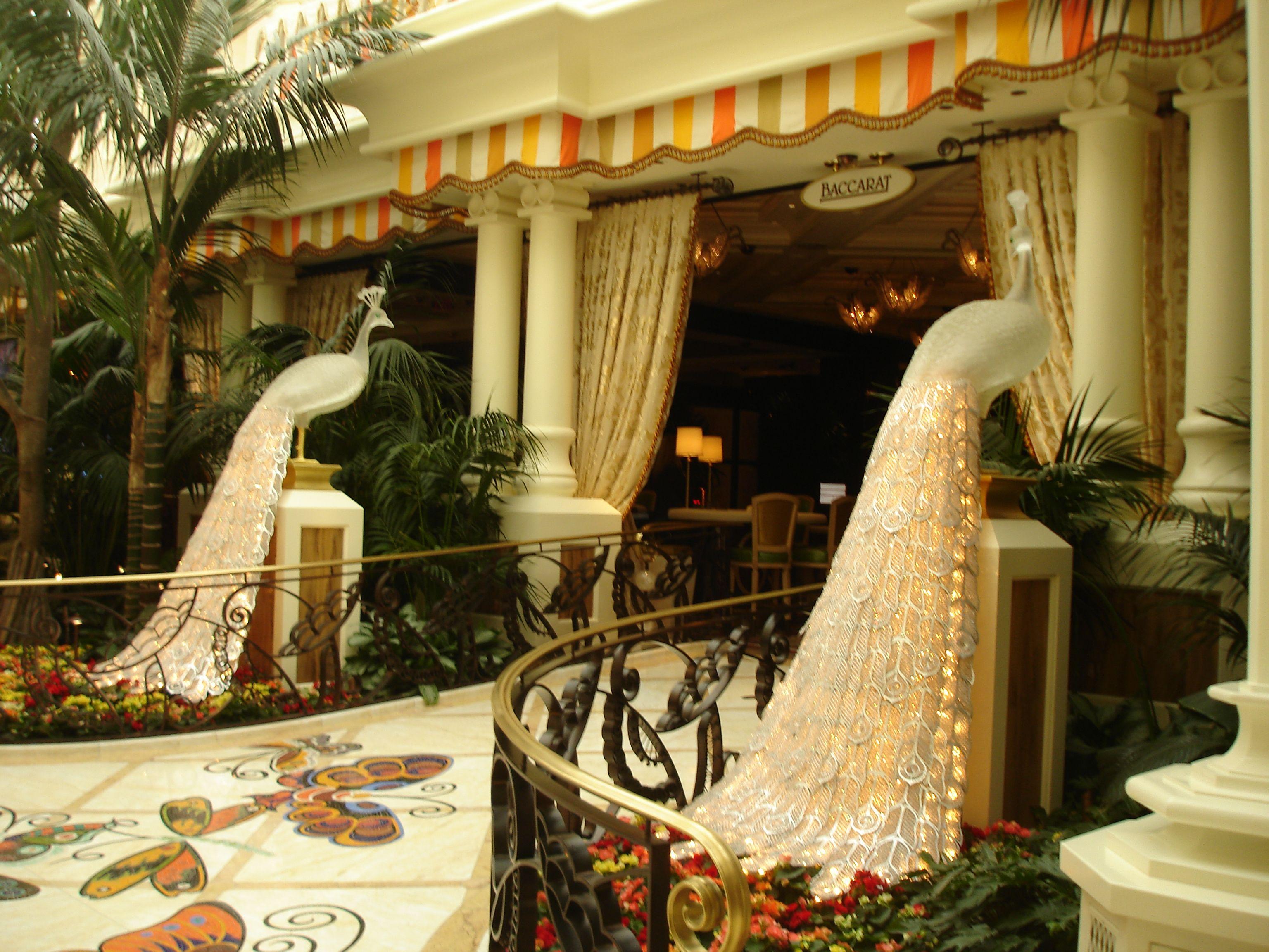 Lighted glass peacocks adorn the entrance to the restaurant. Wynn Hotel - Las Vegas