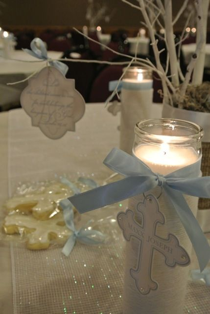 Beautiful, all white candles with ribbon around to put by centerpieces down the table