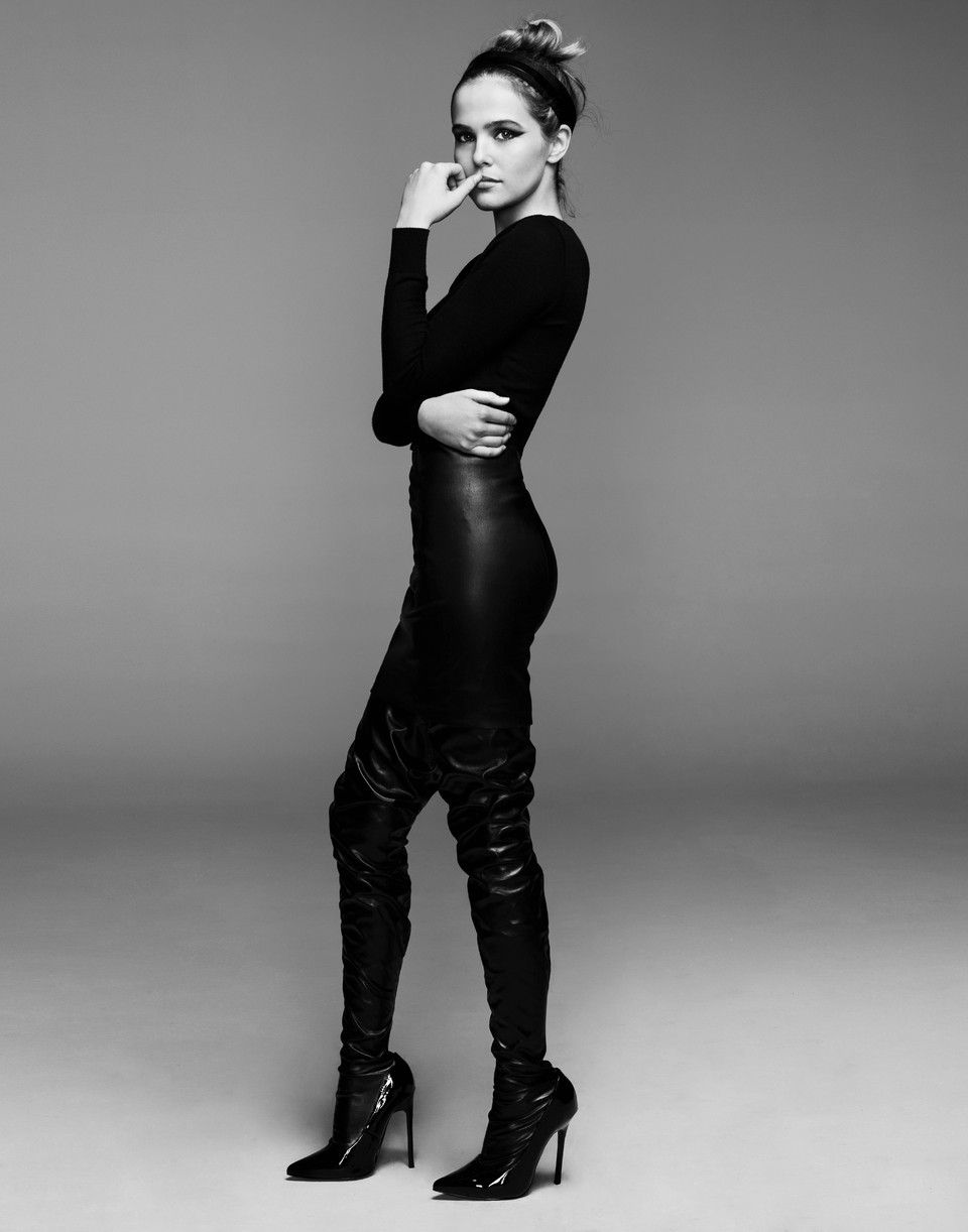 Zoey Deutch stands tall with thigh high leather boots