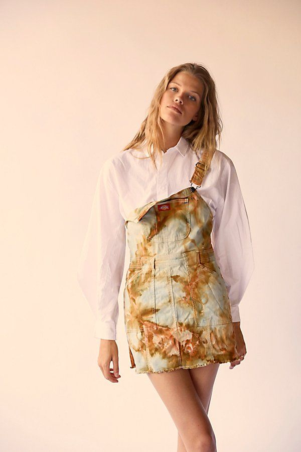 Femme and fun with a utility-inspired twist, this classic Dickies skirtall is featured in a gorgeous tie dyed print with raw bottom hem for the perfect lived-in look.