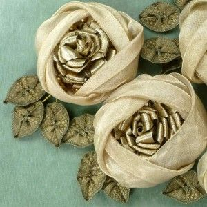Antique French Ribbons, Center of rose and leaves are made with rare antique French gold METAL ribbons. The rose bloom has luminous gold organza outside petals. Leaves have gold thread wrapped wire stems